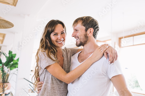 Half length portrait of cheerful positive Caucasian woman hugging lovely husband Canvas-taulu