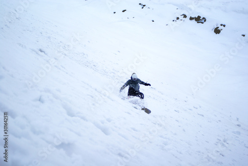 Snowboarder manoeuvres on the downhill snow - Apatity mountain Russia Wallpaper Mural
