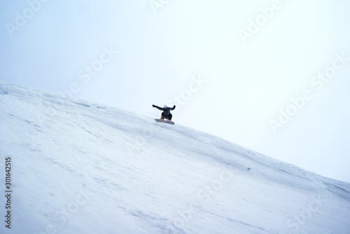 Extremely snowboarder's big jump - Apatity mountain Wallpaper Mural