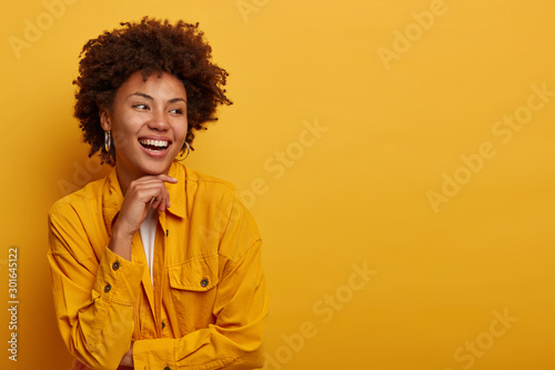 Photo of cheerful African American woman with natural beauty, carefree expressio Canvas Print
