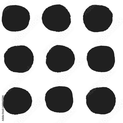 Fotografía  Seamless repeat pattern with big bold black irregular hand-drawn polka dots in r
