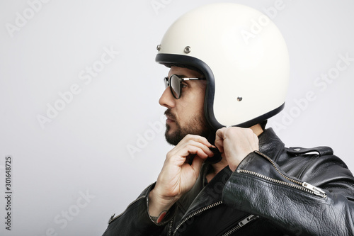 Close-up portrait of biker guy with white helmet. Isolated. Canvas Print