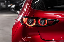 Close Up Detail On One Of The LED Red Taillight Modern Red Crossover Car. Exterior Detail Automobile..