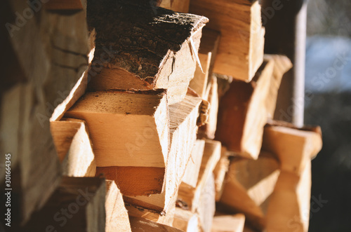 Foto op Plexiglas Brandhout textuur Background of dry lumber for heating the bath and fireplace in winter or autumn