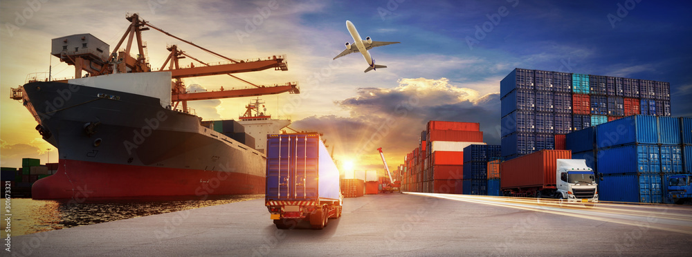 Fototapety, obrazy: Container truck in ship port for business Logistics and transportation of Container Cargo ship and Cargo plane with working crane bridge in shipyard at sunrise, logistic import export and transport