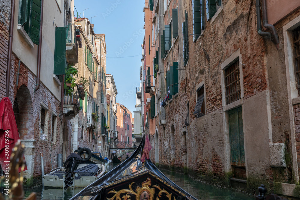 Fototapety, obrazy: Panoramic view of Venice narrow canal with historical buildings from gondola