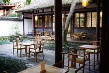 Traditional Setting Of An Outdoor Oriental Tea House With Wooden Table And Chair At Chengdu, China.