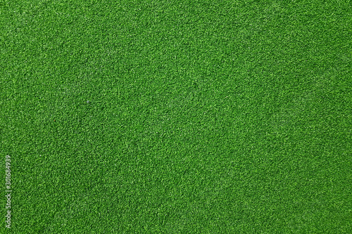 Tuinposter Groene Texture of fake green grass for background or backdrop.