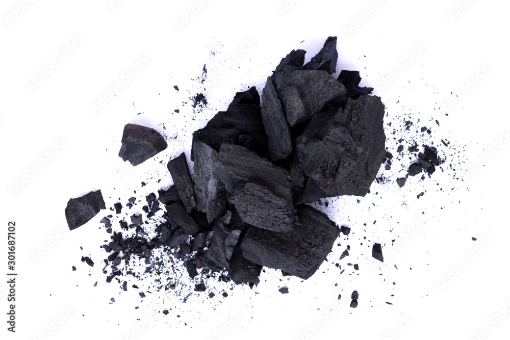 Fototapety, obrazy: Pile of natural broken black activated charcoal granular and powder isolated on white background.