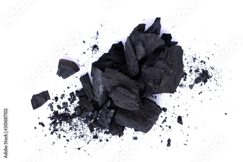 Foto op Plexiglas Brandhout textuur Pile of natural broken black activated charcoal granular and powder isolated on white background.