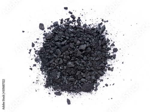 Foto op Plexiglas Brandhout textuur Pile of granular black activated charcoal isolated on white background. Top view. Flat lay.