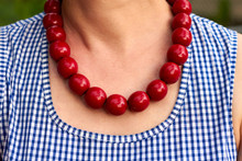 Necklace With Red Beads Around...
