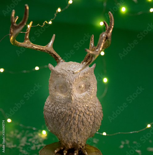 White and gold owl with golden warm fairy lights on green background Wallpaper Mural