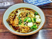 """Street Food In Thailand Called """"Kao Lao Moo Toon"""",Noodles Soup In Bowl,"""