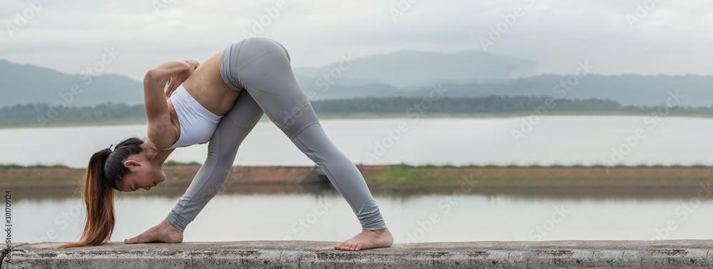 Fototapety, obrazy: Yoga woman workout on the lake.