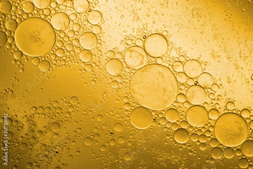 Biodiesel, bubbles biofuel, vegetable oil, yellow and orange emulsion bubbles background - 301709142