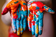 Closeup of woman hands dirty with acrylic paint. Creative finger painting.