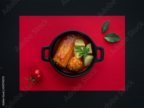 Fototapeta Green pepper stuffed with pork and rice in tomato sauce. Traditional Slovak food. Minimal concept. obraz