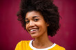 Close up of happy young african american woman smiling by red background