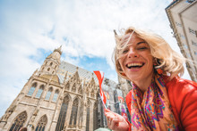 Woman Stands On The Background Of St. Stephen's Cathedral In Vienna With The Flag Of Austria In Hand, Austria