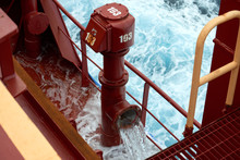 View Of Ballast Water Exchange Process Onboard Of A Ship Using Flow-through Method Underway In Open Ocean. Overflow Method Through Ballast Tank Air Head.