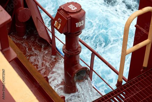 Photo View of Ballast Water exchange process onboard of a ship using flow-through method underway in open ocean