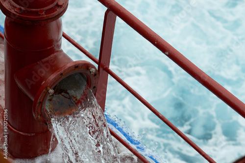 View of Ballast Water exchange process onboard of a ship using flow-through method underway in open ocean Wallpaper Mural