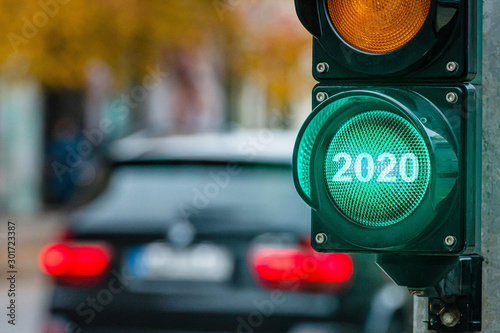 Obraz A city crossing with a semaphore. Green light with text 2020 in semaphore. New Year concept. - fototapety do salonu