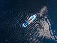 Man Rowing Oar On Sup Board Bl...