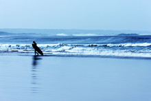 A Surfer At The Beach Of Essaouira.