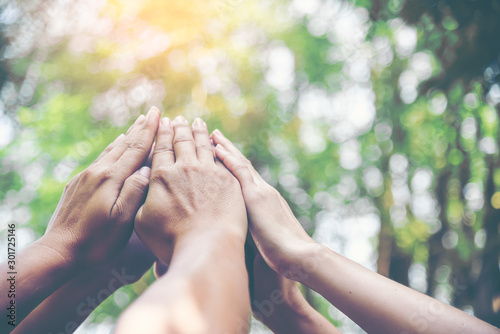 People hands assemble as a connection meeting teamwork concept Wallpaper Mural