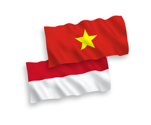 National Vector Fabric Wave Flags Of Indonesia And Vietnam Isolated On White Background. 1 To 2 Proportion.