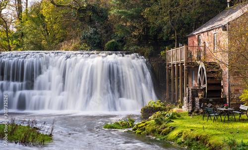 Foto auf Leinwand Wasserfalle Rutter Falls, Cumbria - Picturesque waterfall and mill near Appleby, Cumbria