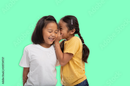 Little asian two girls laughing and smiling enjoy friendship together isolated from background