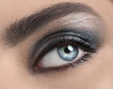 Beautiful Woman Eye Close-up. Young Woman Blue One Eye Macro Shoot. Holiday Smoky Eyes Make-up, Macro Closeup Eye Looking Up, Closeup. Eyelashes, Eyebrows, Iris Close-up