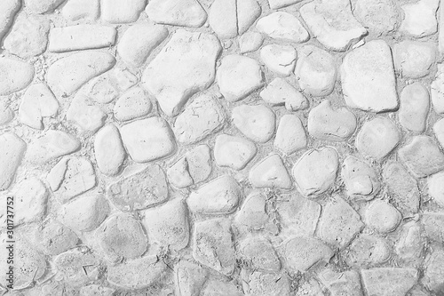 old stone pavement background / abstract pavement, large cobblestones, old road texture