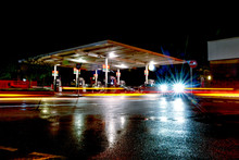 Gas Station At Night With Ligh...