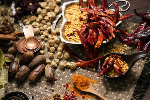 Photo  Spices and herbs on old kitchen table.