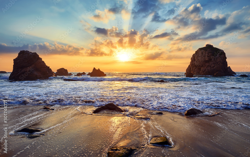 Fototapety, obrazy: Sand beach among rocks on evening sunset. Ursa Beach near Cape Roca (Cabo da Roca) at Atlantic Ocean coast in Portugal. Summer landscape.