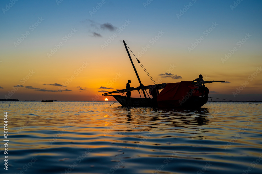 Fototapety, obrazy: Traditional fisherman dhow boat during sunset on Indian ocean in island Zanzibar, Tanzania, East Africa