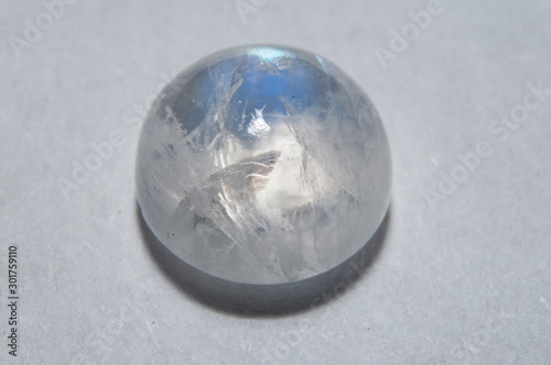 Natural white blue adular moonstone on the white background Tapéta, Fotótapéta