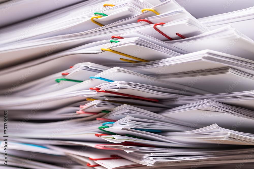 Fototapeta Stack overload document report paper.