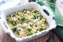 Baked Broccoli With Chicken In A Ceramic Form On A Wooden Table, Selective Focus