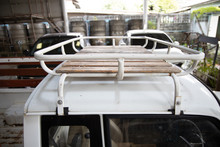 Vintage White Steel Roof Cargo Basket Luggage Carrier Rack With Wooden Floors Installed On The Roof Of The Car.
