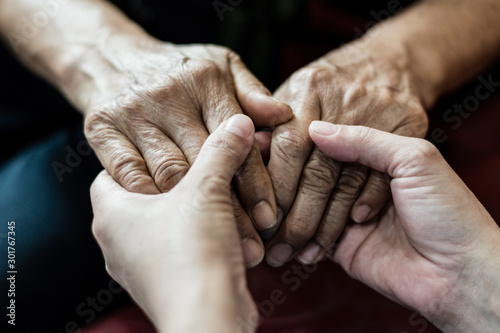Photo Parkinson and Alzheimer female senior elderly patient with caregiver in hospice care
