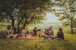 canvas print picture - Group of friends eating in the nature