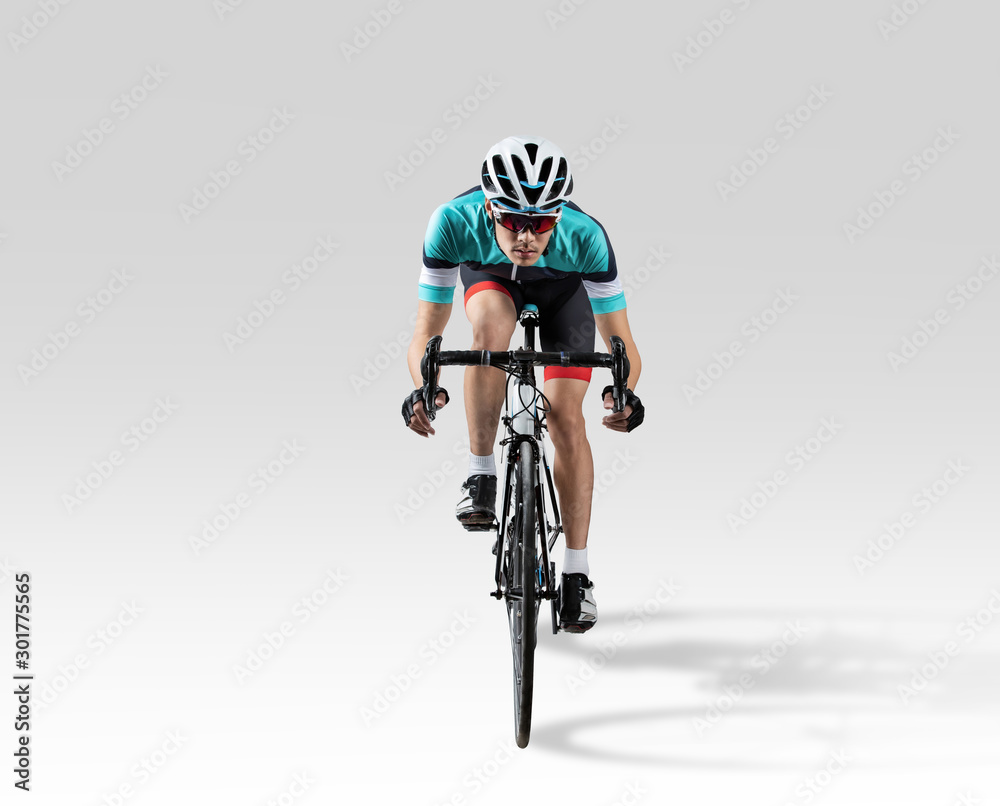 Fototapeta Handsome asian riders he is cycling in the studio.