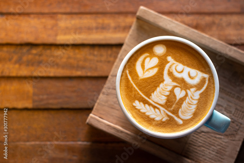Latte art coffee on wooden table Canvas Print