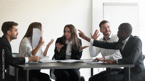 Photo Mad diverse employees dispute at office meeting