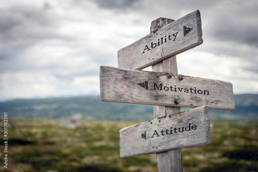 Fototapeta Ability, motivation and attitude text on wooden sign post outdoors in landscape scenery. Business, quotes and motivational theme concept.